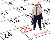 It's finally christmas - businessman standing on calendar