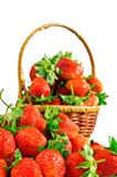 juicy red strawberries in basket on white background