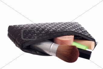 Beautiful black makeup bag and cosmetics
