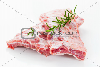 Raw spare ribs with rosemary