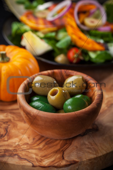 Delicious green olives with salad