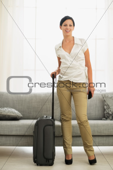 Smiling young woman ready for trip