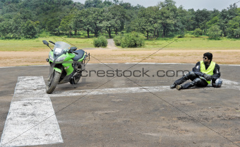 Superbike and rider on helipad