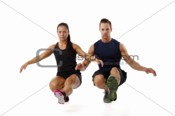 Cople doing one leg squat