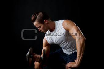 Male doing dumbbelll lifts