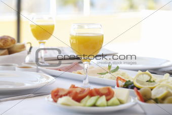 Fresh orange juice on breakfast table