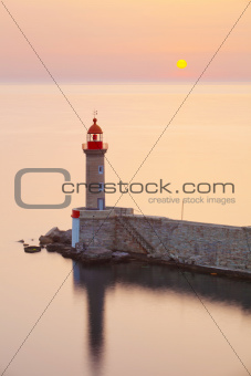 Lighthouse and sun