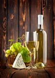 White wine with grapes and blue cheese