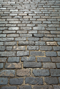 Old London cobblestone street close up.