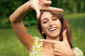 Smiling Woman Making Frame with Her Hands