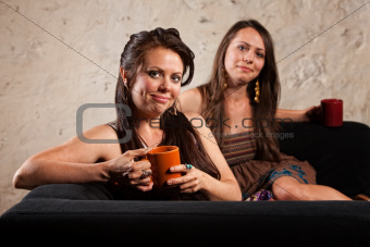 Satisfied Coffee Drinkers on Sofa