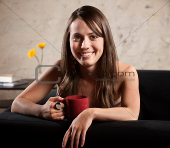 Attractive European Woman with Mug