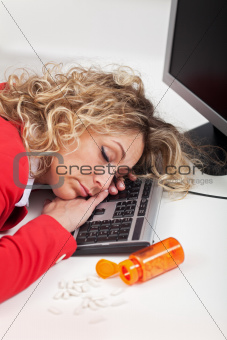 Exhausted woman asleep at work
