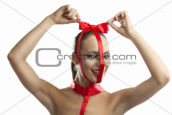 beauty portrait of girl with red bow with hands on the head