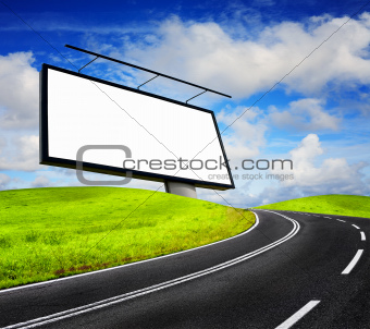 Blank billboard against blue sky