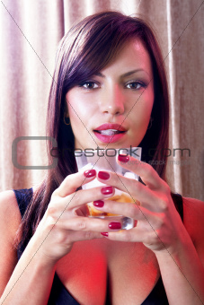 girl with glass of whisky
