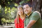 Happy Attractive Mixed Race Couple Portrait at the Park