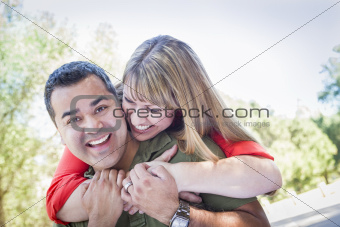 Happy Attractive Mixed Race Couple Piggyback at the Park.