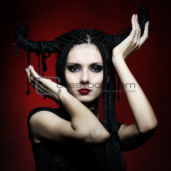 Beautiful woman in carnival costume. witch shape with Horns.