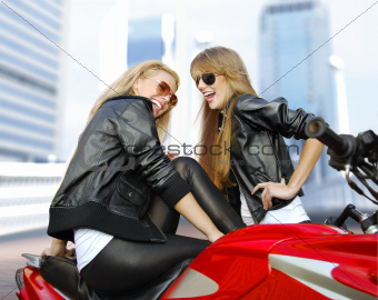 two cheery motorcyclists and motorcycle