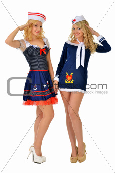 Two beautiful women in sexy sailor costumes