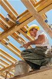 Smiling construction worker busy under slab formwork beams
