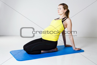 Pregnant woman stretching and relaxing