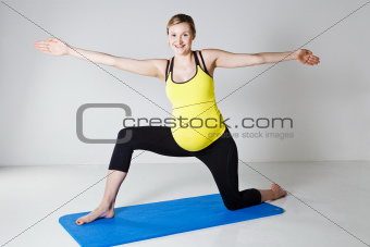 Pregnant woman doing yoga exercise