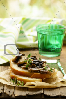 Sandwich crostini  with fried mushrooms and thyme