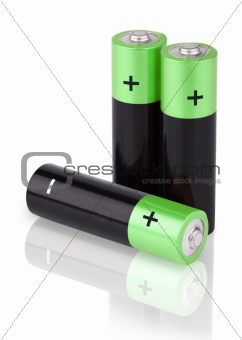 Closeup of three AA batteries on white