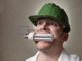 Engineer with Energy Saving Lightbulb