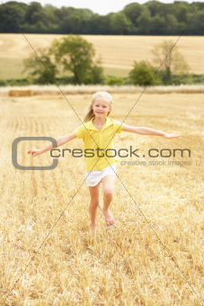 Girl Running Through Summer Harvested Field