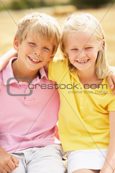 Portrait Of Boy And Girl In Summer Harvested Field