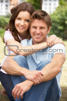 Affectionate Couple Relaxing At Home In Garden Together