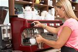 Woman Making Coffee In CafŽ