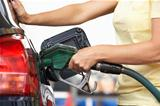 Detail Of Female Motorist Filling Car With Petrol At Petrol Station