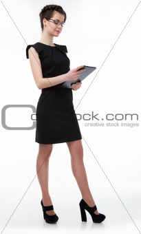 Cute business woman in spectacles with computer