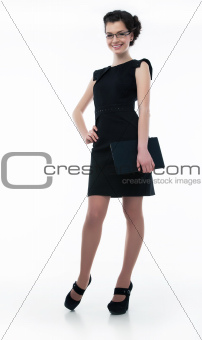 Stylish business woman in glasses in black dress with laptop