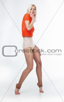 Sensual slim blonde girl posing in studio