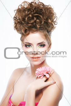 Attractive brunette woman with flower. Bright makeup