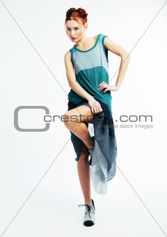 Fashion model red hair girl in modern dress posing