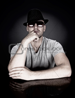 man in hat and sunglasses