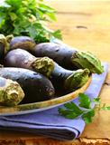 Organic ripe purple eggplant on a wooden table