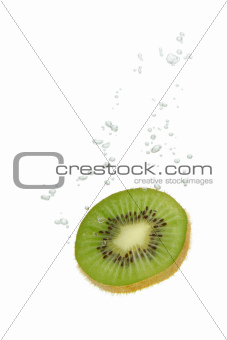 Kiwi fruit in water with air bubbles