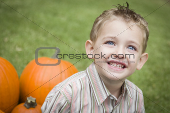 Adorable Young Child Boy Enjoying the Pumpkins at the Pumpkin Patch.