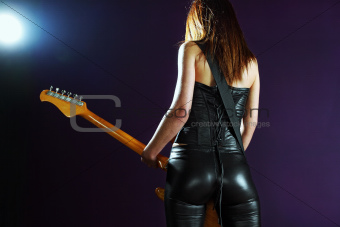 Sexy female playing an electric guitar