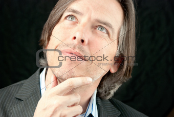 Businessman Looking Up and Pondering