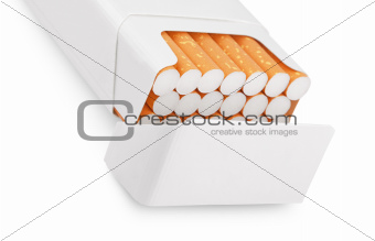 Open pack of cigarettes on white