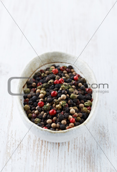 Assorted peppercorns in a dish