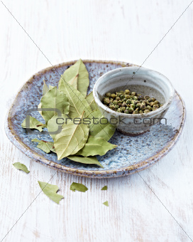 Bay leaves and green peppercorns